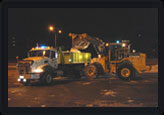 Snow removal with front end loader and dump truck
